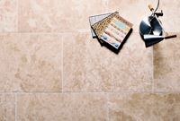 How to seal natural stone tiles before grouting
